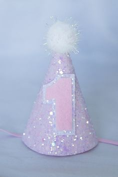 Glittery Birthday Party Hat Shown is our mini party hat with Candyfloss glitter fabric, pink felt/pastel ab number 1 with a white sparkle pom 1st Birthday Hats, Baby First Birthday, First Birthday Parties, First Birthdays, Birthday Ideas, Winter Onederland, 1 An, Glitter Fabric, Cake Smash