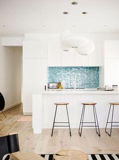 Blue backsplash in a white kitchen