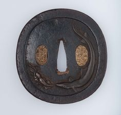 Tsuba with design of fishes and squid | Museum of Fine Arts, Boston