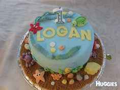 this cake was made by my wife for our sons 1st birthday everything was hand made and is edible there are fish, crabs, starfish, a turtle an octopus ect. he loved it!!