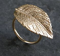 Check out this item in my Etsy shop https://www.etsy.com/listing/83288601/leaf-gold-ring-statement-gold-ring