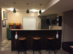 Bar in basement. The bar is made out of a bowling lane.