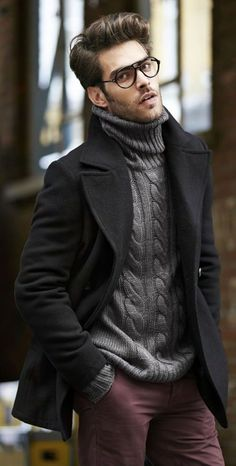 purple pants, a grey cable knit sweater, a black coat