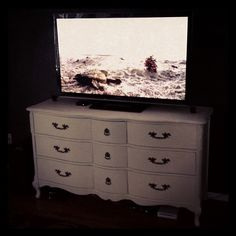 Antique Dresser ($70) Refinished with Annie Sloan's Chalk Paint and minwax paste wax.  Perfect TV stand!