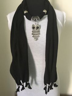 A personal favorite from my Etsy shop https://www.etsy.com/listing/499038506/black-energy-wrap-with-owl-pendant-scarf