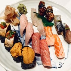 """Monkfish liver, Uni, Yellowtail Belly, Toro, Engawa, Salmon Belly, Unagi, & Mackerel "" from Sushi Gen"