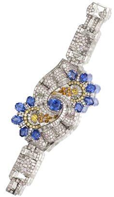 AN IMPRESSIVE ART DECO SAPPHIRE, DIAMOND AND COLOURED DIAMOND BRACELET, by Oscar Heyman