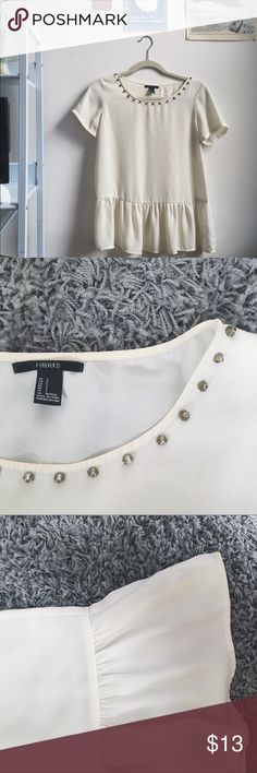 HOST PICK Studded Collar Cream Peplum Blouse 08/05/2017 VACATION STYLE HOST PICK!! The super lightweight top is perfect for the office or school, paired with blue jeans or a pencil skirt it's versatile and chic! The studded collar is gorgeous and simple, and adds to the sweet look of the peplum. 100% polyester, worn once! Forever 21 Tops Blouses