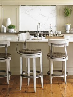 Create a beachy and relaxed feel at your bar or kitchen counter with this bar-height swivel stool. Woven rushes adorn the seat, making a beautiful, natural pairing with the seashell-toned, white wood finish. The casual and coastal look adds a bit of summertime to any room, from an indoor bar area to a covered porch.