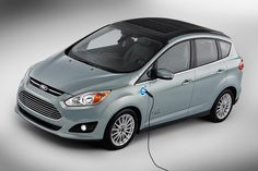 Electric ford C-MAX solar energi concept - instead of powering its battery from an electrical outlet, the concept car harnesses the energy of the sun by using a special concentrator that acts like a magnifying glass, directing intense rays to solar panels on the vehicle's roof.