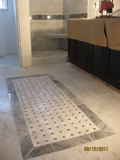 """Area-Rug"""" out of basket-weave marble. Also heated floor   Yelp"""