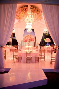 A beautiful pink wedding reception! Very princessy! it seemed like a princess just got married! <3