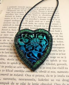 Foil-resin pendant by Created By Sonja, via Flickr