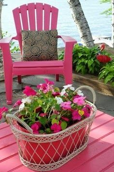 Pink chair and basket by the lake!