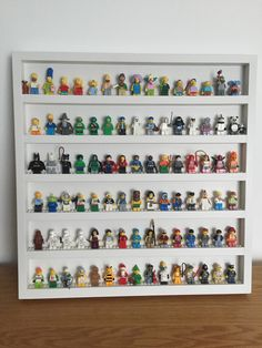 Lego display case from BrickNerdDisplay available to order in white and black from our Etsy shop  https://www.etsy.com/uk/listing/273715512/lego-minifigure-wall-frame
