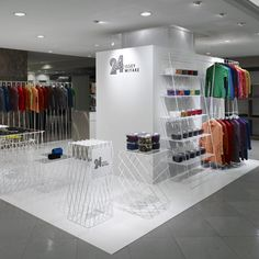 white color fashion store design of 24 Issey Miyake