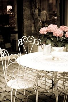 Cafe table in Paris - I don't know if this is a cafe I've been to but it's quintessential Paris.