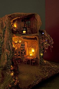 A lovely little abode any little Fae would love to live it.......Fairy Tree Trunk House @ Night by Torisaur, via Flickr