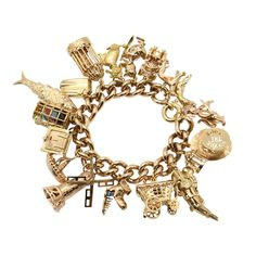 A 1960s Gem Set Gold Charm Bracelet   From a unique collection of vintage charm bracelets at https://www.1stdibs.com/jewelry/bracelets/charm-bracelets/