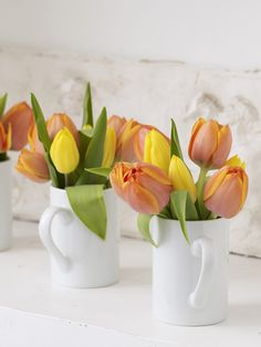 A simple bouquet of flowers using coffee mugs in the kitchen. - Brought to you by LG Studio