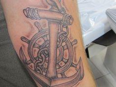 Anchor, chain and ships wheel