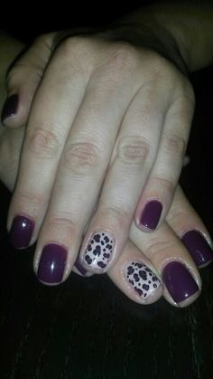 "Orly ""Plum noir"" with animal print nail design"