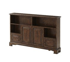 A cerejeira veneered and mahogany low bookcase, the moulded edge rectangular top above an arrangement of open shelves and panelled and banded cabinet doors, on ogee bracket feet.