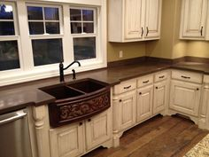 Brown Concrete Countertops Backsplash with white cabinets- not crazy about this sink though.