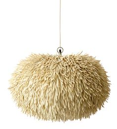 Drawing inspiration from below the ocean, this organically shaped hanging lamp looks like a large sea anemone. It is made from coco sticks, which are sticks carved from coconuts, a highly labour intensive process. The Anemone Lamp will be a talking point in any room. This range also consists of an Anenome Floor Lamp.