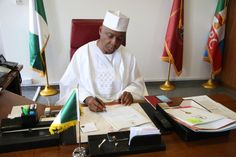Bukola Saraki signs the Senate's notice to the  Executive on the confirmation of new Chief Justice, Walter Onnoghen