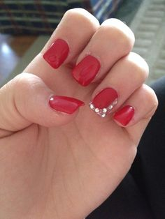 Got red nails for prom. Jems and sparkles were added.
