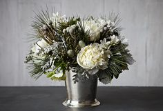 A Gorgeous Wintry White Arrangement in 4 Easy Steps ~ Inspired by a shimmering winter sky, this cloudlike burst of blooms is deceptively easy to create.