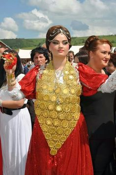 Sandžak bride in red traditional clothes (kat)and gold necklace. Necklace is made from real gold it is very heavy. Sandžak (Serbian Cyrillic: Санџак, pronounced [sǎndʒak]) is a historical geo-political region, now divided by the border between Serbia and Montenegro.