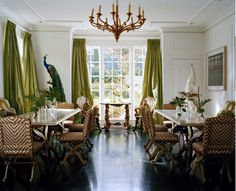 Nice size dinning room. Love the two tables and the green silk curtains.