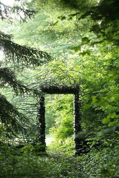 "Mt. Airy Forest, Ohio. ""Gateway"" Sculpture installation made from wood & stones."