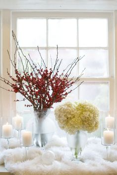 apothecary jars/flowers: red winter berries and white hydrangea