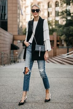 The soft flow of the blouse contrasts to the sharp tailoring of the vest and the clean lines of the pointy flats and the crisp bag. And all of that is balanced by the distressed jeans. Sleeveless Blazer Outfit, Black Vest Outfit, Vest Outfits, Casual Outfits, Fashion Mode, Fashion Outfits, Style Fashion, Fashion Tips, Slingback Chanel
