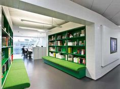 Interesting use of color to punctuate a neutral office. Using it in walkways and bookshelves for a pop.
