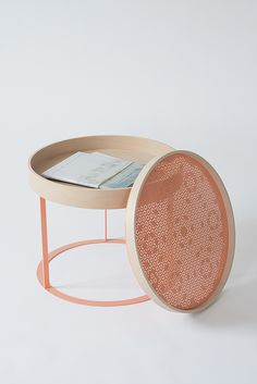 Utterly gorgeous 'Cooper'  side table from Nina Mair. The top also serves as a tray, and the table comes in a variety of colors of wood.