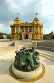 """Background, Croatian National Theatre and in the foreground is the famous fountain, the """"Fountain of Life"""" by the Croatian sculptor Ivan Mestrovic"""