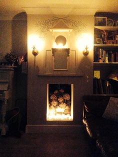 My simulated fireplace with the bespoke olive branch mural with gold leaf olives. Works really well with the flickering candlelight. Underfloor Heating, Surface Pattern Design, Olives, Gold Leaf, Home Renovation, Hygge, Cosy, Hand Painted, Candles