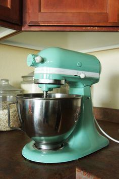 Oh, neat!! Someone re-painted their old Kitchenaid to be mint green, or rather, their hubby did. Very smart! [I'm lucky enough to already have a teal one myself, but if I didn't...I'd figure out how to do this]