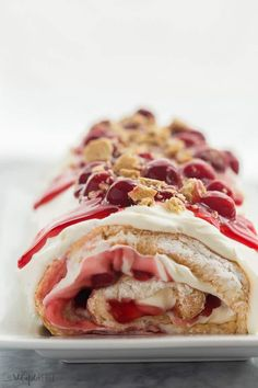 This Cherry Cheesecake Angel Food Cake Roll is the best kind of roll cake! It's made with light and fluffy angel food cake, and filled with a sweetened cream cheese whipped cream and cherry pie filling. Angle Food Cake Recipes, Cake Roll Recipes, Cheesecake Recipes, Strawberry Cheesecake, Easy Desserts, Delicious Desserts, Dessert Recipes, Yummy Food, Light Desserts