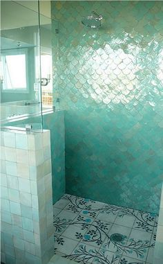 It's like a mermaid's tail. Love the color and shape of that wall tile. Floors... Not so much.