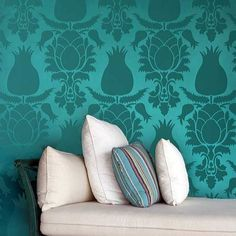 """I wonder how they make the paler background glow like that.  Do you think they """"burnished"""" the wall before painting the darker stencil on top?  Is the background possibly a satin paint while the darker stencil is matte?  Hmm.  All I know is the effect is that of silk damask on the wall.  Pretty neat trick with paint."""
