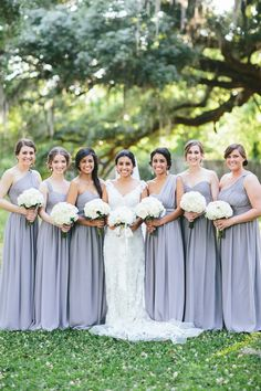 Beautiful bride and her bridesmaids in perfectly  mismatched bridesmaids dresses by Donna Morgan (in Sterling shade)