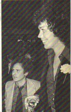 Art Garfunkel and Tim Curry.