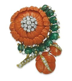 A CORAL, EMERALD AND DIAMOND FLOWER BROOCH, BY DAVID WEBB  Designed as a stylized peony with carved coral petals and leaves, a diamond-set stem, and centering upon a brilliant-cut diamond pistil, to the emerald bead partial surround, with diamond detail, mounted in platinum and gold