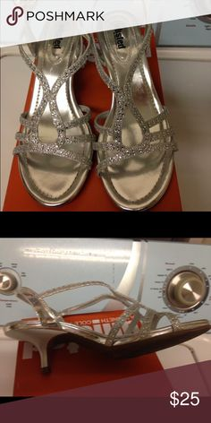 DSW brand heels Silver size 8.5 my daughter wore once to prom they are in excellent condition. Paid over $40 last year. DSW Shoes Heels