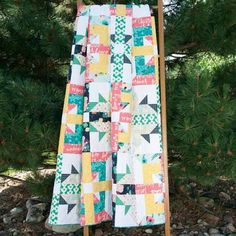 Warmest Wishes Quilt Kit: Bright prints from the Happy Home collection by Sew Caroline for Art Gallery Fabrics give this queen-size quilt loads of personality.